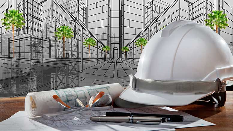 construction hat over architectural drawing